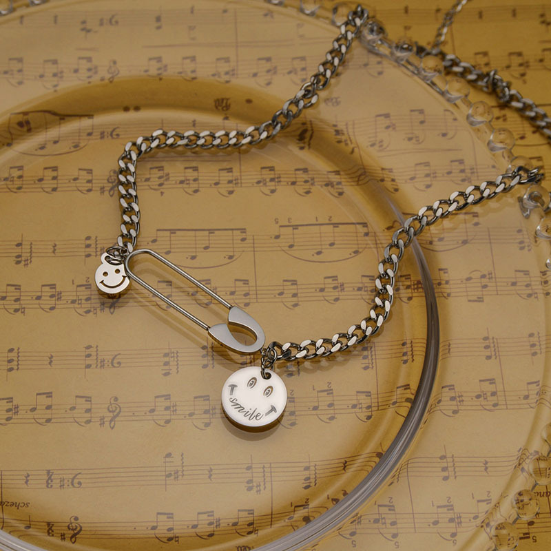 Simple smiley face round brand titanium steel necklace wholesale NHHF336337