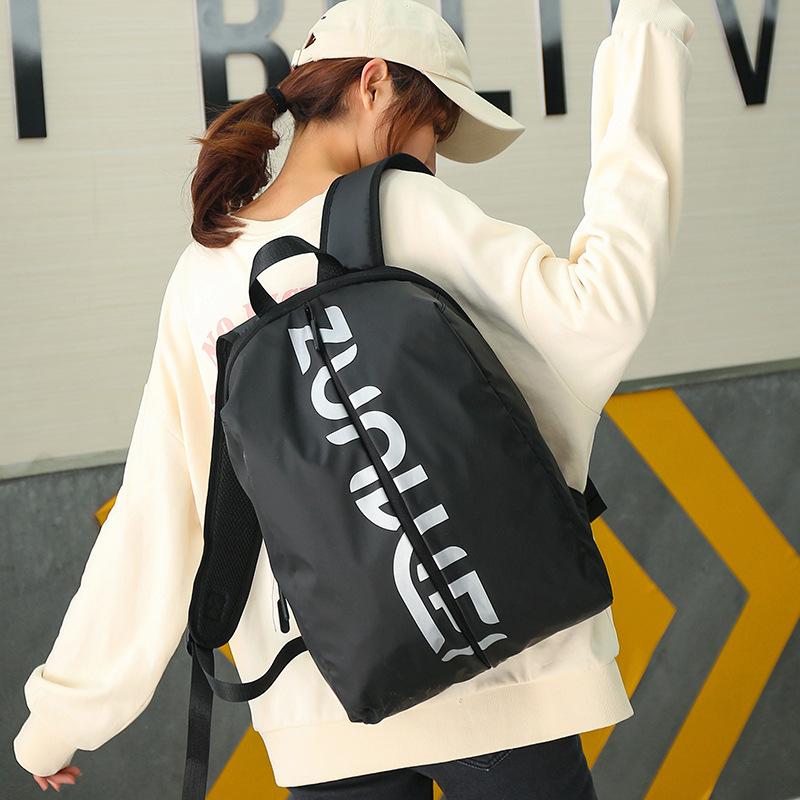 户外双肩包女生轻便旅行包日韩版休闲运动背包简约字母学生双肩包