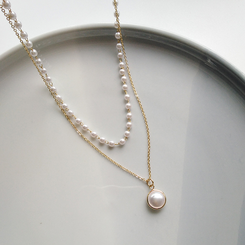 Fashion pearl multilayered alloy necklace wholesale NHBY334963